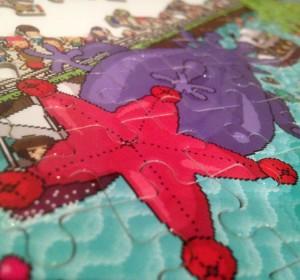 <span>Arkham Parade puzzle</span><i>→</i>